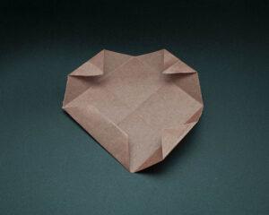 Fold corners along existing crease.